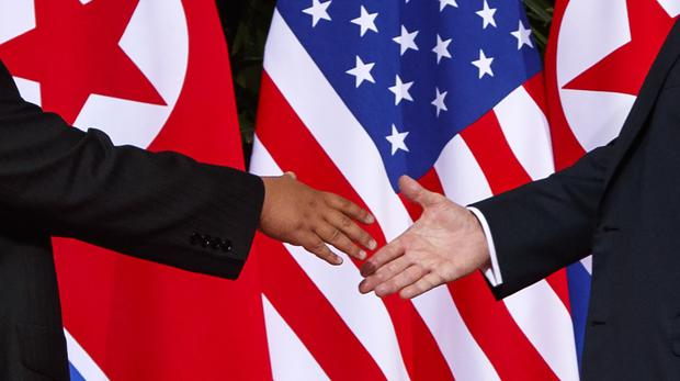 Donald Trump reaches to shakes hands with Kim Jong Un (Evan Vucci/AP)