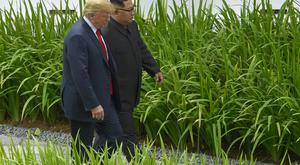 Donald Trump and Kim Jong Un walk from lunch at the Capella resort (Anthony Wallace/pool/AP)