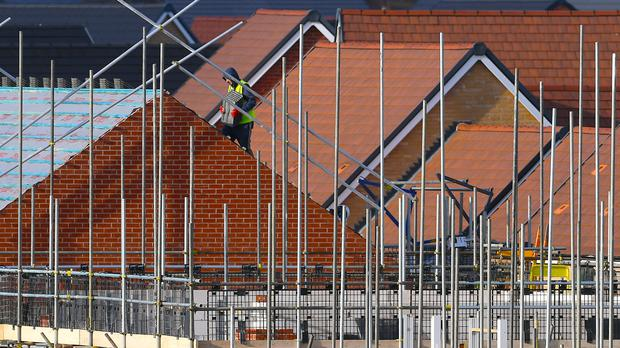 Housebuilder Crest Nicholson has revealed falling half-year profits and warned the squeeze from stalling house prices and rising build costs will continue into next year (Joe Giddens/PA)