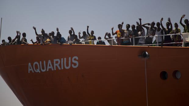 Migrants wave from the Aquarius rescue ship (AP Photo/Emilio Morenatti)