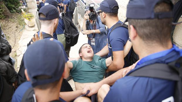 Police evict a Jewish settler at the West Bank settlement of Netiv Avot (AP Photo/Ariel Schalit)
