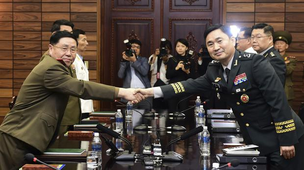 South Korean Maj. Gen. Kim Do-gyun, right, shakes hands with his North Korean counterpart Lt. Gen. An Ik San (South Korea Defense Ministry via AP)