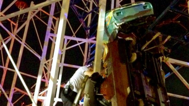 Emergency crews work on a roller coaster car that derailed in Florida (Daytona Beach Fire department via AP)