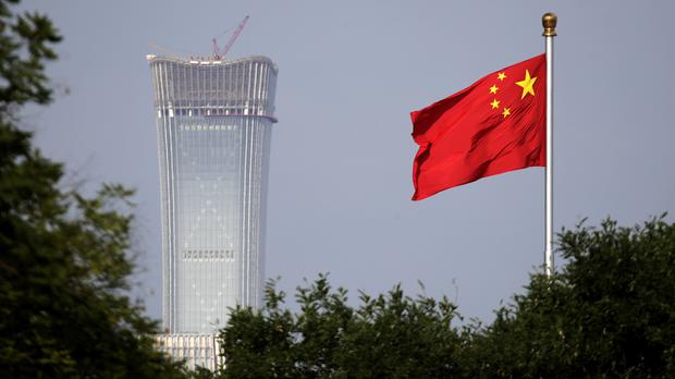 China has said that it will retaliate (Andy Wong/AP)