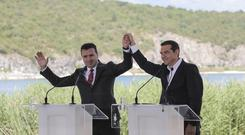 Alexis Tsipras, right and Zoran Zaev signed a deal which launches a long process that will last several months (Yorgos Karahalis/AP)