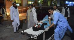 A wounded man is taken by stretcher into a hospital in Jalalabad (Mohammad Anwar Danishyar/AP)