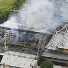 Smoke rises from a house blaze in Takatsuki, Osaka, following the earthquake (Kyodo News via AP)