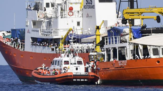 An Italian Coast Guard boat approaches the Aquarius ship (Salvatore Cavalli/AP)