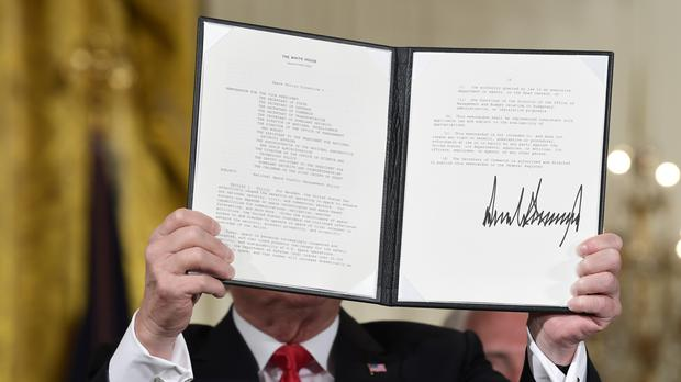 President Donald Trump shows off a 'Space Policy Directive' (Susan Walsh/AP)