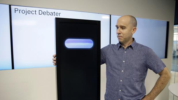 Dr Noam Slonim with the IBM Project Debater (AP Photo/Eric Risberg)
