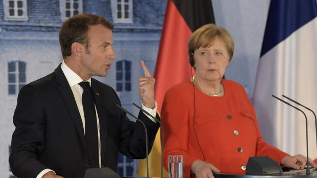 Emmanuel Macron and Angela Merkel (AP Photo/Jens Meyer)
