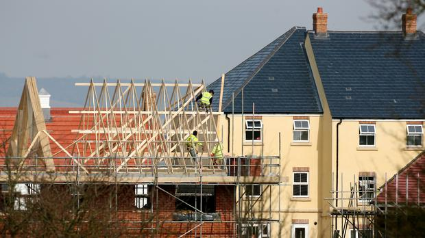 Builders at work on new homes being built around Ashford in Kent (PA)