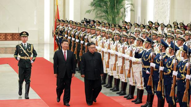 Xi Jinping and Kim Jong Un inspect the honour guard at the Great Hall of the People in Beijing (Korean Central News Agency/Korea News Service via AP)