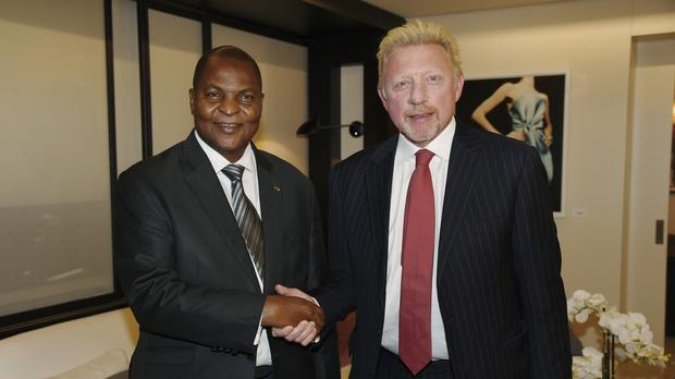 Boris Becker with President Faustin Archange Touadera (Irle Moser Rechtsanwalte PartG via AP Images, FILE)
