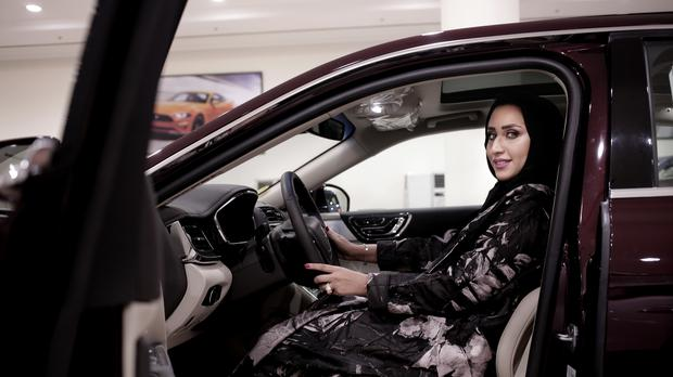 Car saleswoman Maram inside a Lincoln Continental at the Al-Jazirah Ford showroom in Riyadh. (AP/Nariman El-Mofty)