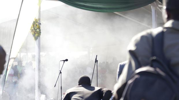Smoke fills the stage following an explosion at a Zanu PF rally in Bulawayo. (AP)