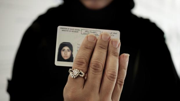 A Saudi woman holds her new driving license as a ban on women driving is lifted. (AP/Nariman El-Mofty)