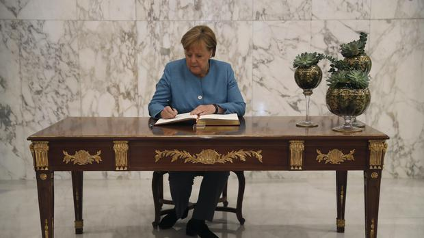 German Chancellor Angela Merkel is facing a crisis at home (Hussein Malla/AP)