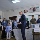 Recep Tayyip Erdogan cast his vote earlier (Lefteris Pitarakis/AP)