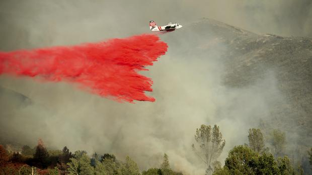 A wildfire is targeted near Clearlake Oaks, California (Noah Berger/AP)