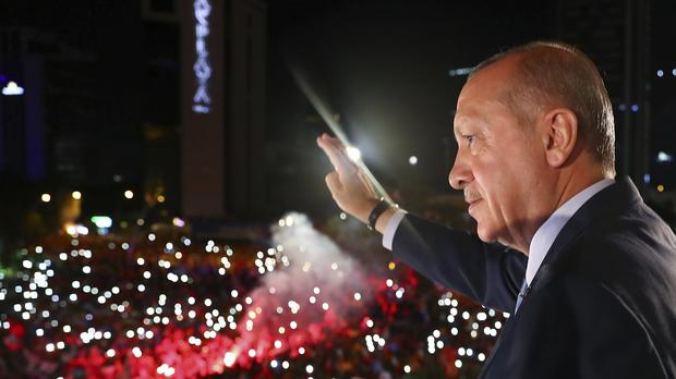 Recep Tayyip Erdogan, waves to supporters (AP)