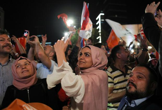 Supporters listen to Recep Tayyip Erdogan give a speech. Photo: Reuters