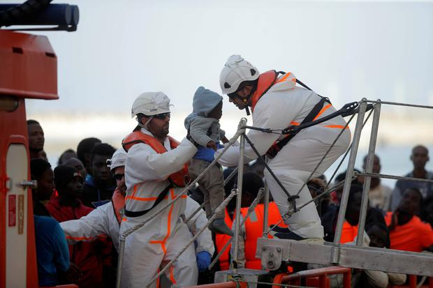 Rescuers carry a migrant child, part of a group intercepted aboard dinghies off the coast in the Mediterranean Sea, after arriving on a rescue boat at the port of Malaga, Spain. Photo: Reuters