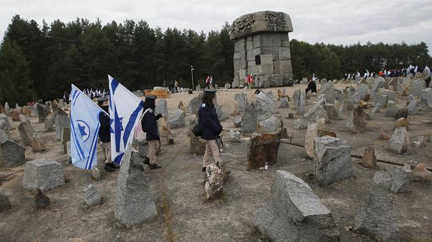Israeli youths march by the monument to some 900,000 European Jews killed by the Nazis between 1941 and 1944 at the Treblinka death camp (AP)