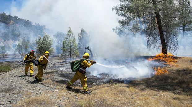 Fire crews battle a wildfire near Cache Creek Road in Spring Valley (AP)