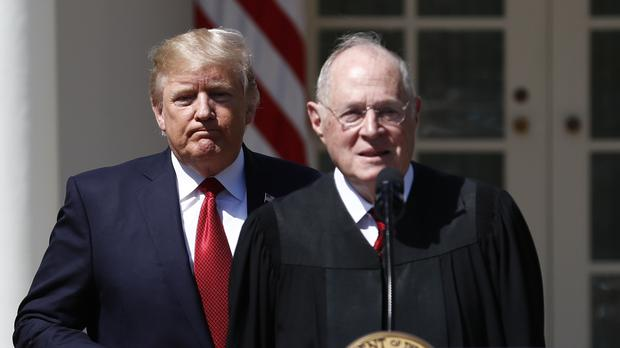 Mr Trump, left, and Supreme Court Justice Anthony Kennedy