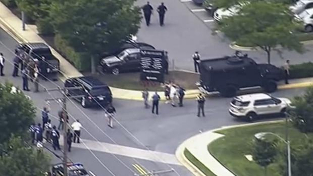 People leave the Capital Gazette newspaper after multiple people were shot (WJLA via AP)