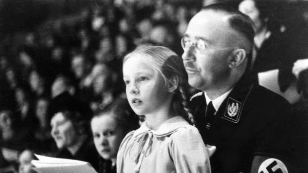 A photo from 1938 showing Heinrich Himmler with his daughter Gudrun (AP)