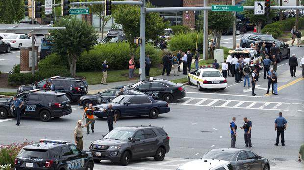 Maryland police officers block the intersection at the building entrance (AP Photo/Jose Luis Magana)