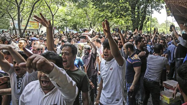 Protesters chanted slogans at the old grand bazaar in Tehran (IIranian Labor News Agency via AP)