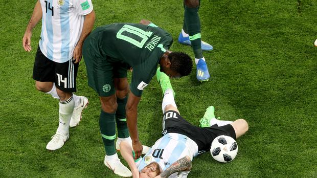 Nigeria's John Obi Mikel speaks to Lionel Messi during the match with Argentina (Owen Humphreys/PA)