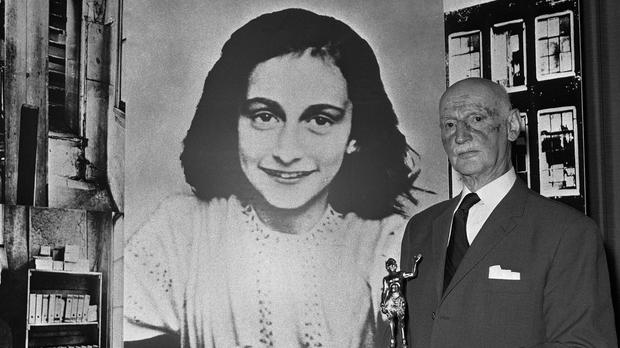 Dr Otto Frank holds the Golden Pan award, given for the sale of one million copies of the famous paperback The Diary Of Anne Frank in London (Dave Caulkin/AP)