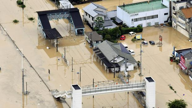 Buildings partially submerged by floodwaters (Shingo Nishizume/Kyodo News via AP)
