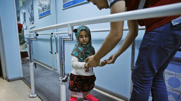 Maya Meri walks on prosthetic legs at a rehabilitation clinic in Istanbul (AP Photo/Lefteris Pitarakis)