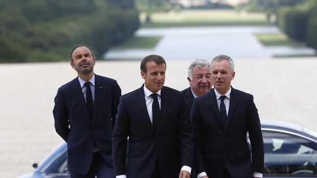 Mr Macron and other senior government figures arrive at Versailles (AP)