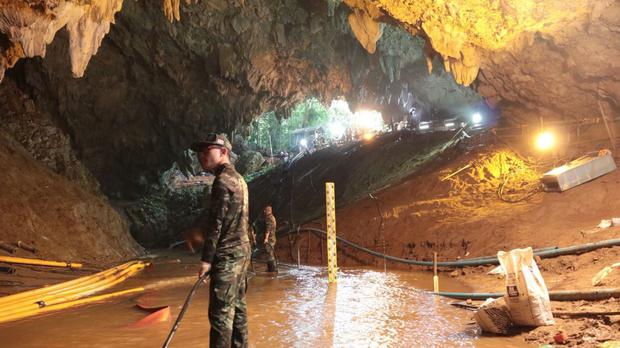 Thai rescue teams at the entrance to the flooded cave complex in Thailand (Royal Thai Navy via AP)