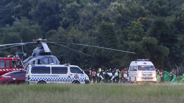 Ambulances carry boys from the cave (AP Photo/Vincent Thian)