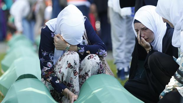 Bosnian Muslim women grieve near the coffin of one of the 35 identified victims of the 1995 massacre (AP)