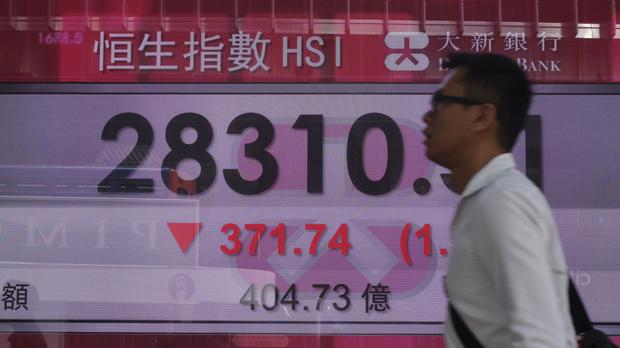 Asian markets are broadly lower after the Trump administration said it was preparing to impose tariffs on 200 billion dollars of Chinese exports (AP)