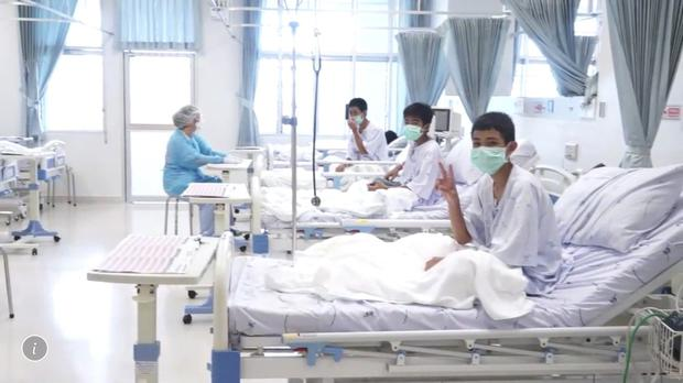 Three of the 12 boys are seen recovering in their hospital beds (Thai Government/AP)
