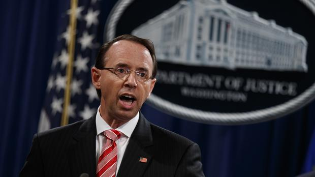 Deputy attorney general Rod Rosenstein announces the charges (Evan Vucci/PA)