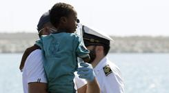More European nations have agreed to take a share of the hundreds of migrants on board (Francesco Ruta/ANSA via AP)