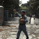 A security officer arrives at the site of a would-be suicide attack near a park in Kabul (AP)