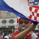 Croatia national soccer team members are welcomed with their national flags waved upon arrival in Zagreb (AP)