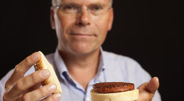 Professor Mark Post with a lab-grown meat burger (David Parry/PA)