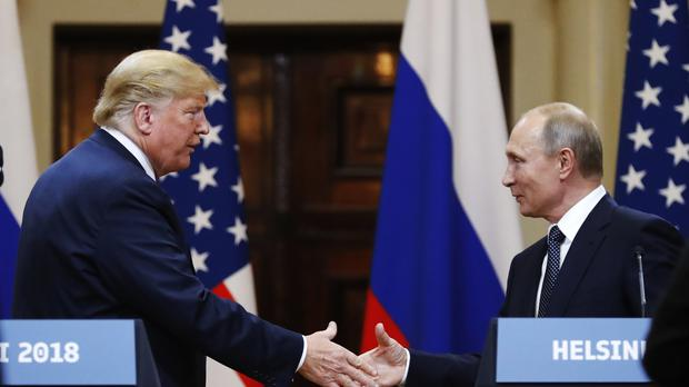 "Donald Trump sought to ""clarify"" comments he made during a press conference with Vladimir Putin (AP/Alexander Zemlianichenko)"